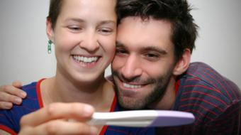 couple viewing pregnancy test