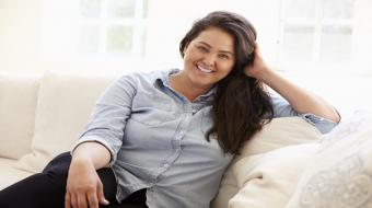 obese girl sitting on couch xlarge