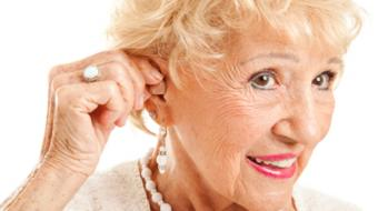 older woman hearing aid